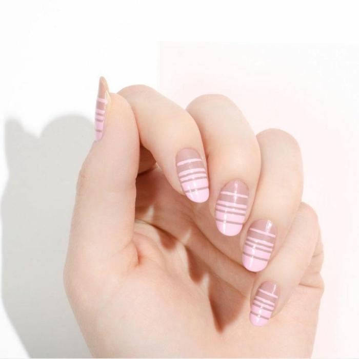 modelos de uñas, bonita idea en tonos pastel, uñas ovaladas en blanco y rosado, decoración de rayas