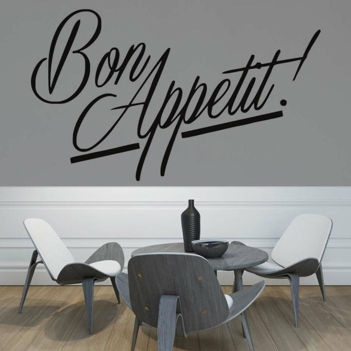 decoracion paredes, comedor moderno con mesa baja, vinilo negro en cursiva sobre pared gris