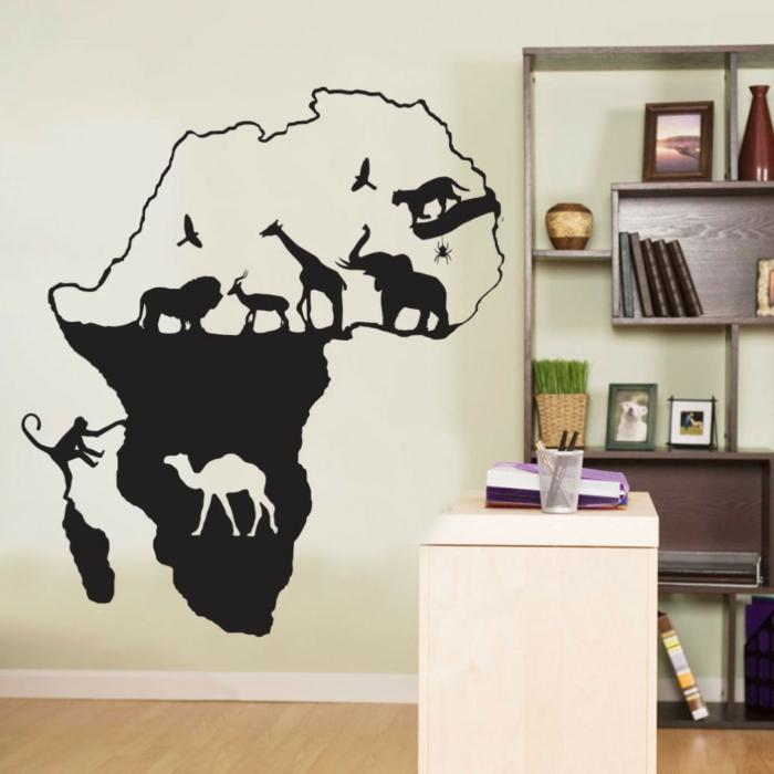 vinilos infantiles, habitación con escritorio, vinilo negro grande con el mapa de Africa y los animales típicos para el continente