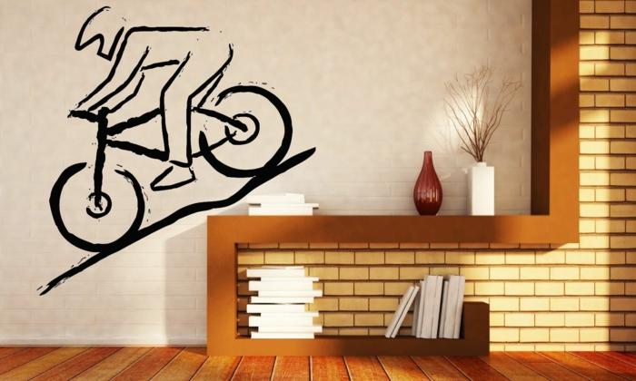 vinilos infantiles, vinilo negro de ciclista bajando una cuesta, pared con ladrillo blanco, decoración sala de estar