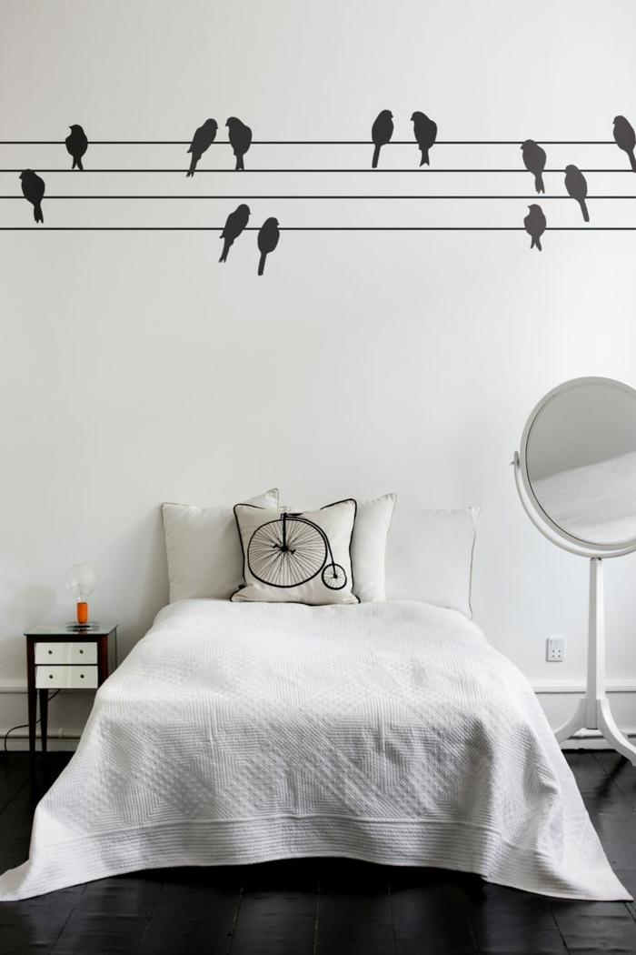 adhesivos pared, dormitorio minimalista en blanco y negro, vinilo negro con golondrinas posadas sobre alambre