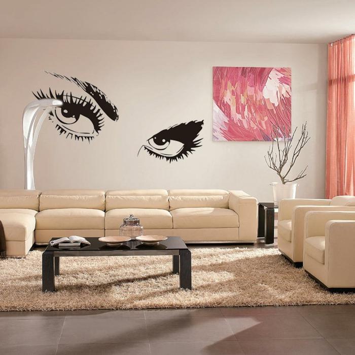 adhesivos pared, salón moderno con sofá de piel beige y alfombra, vinilo grande con ojos abiertos de mujer y cuadro en rosado