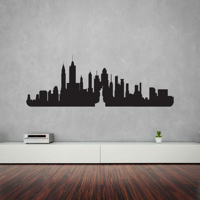 adhesivos pared, decoración moderna salón, pared gris, vinilo grande en negro sólido, horizonte con rascacielos
