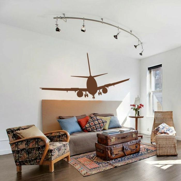 vinilos decorativos, salón pequeño cond ecoración vintage, vinilo marrón con avión atterizando sobre pared blanca