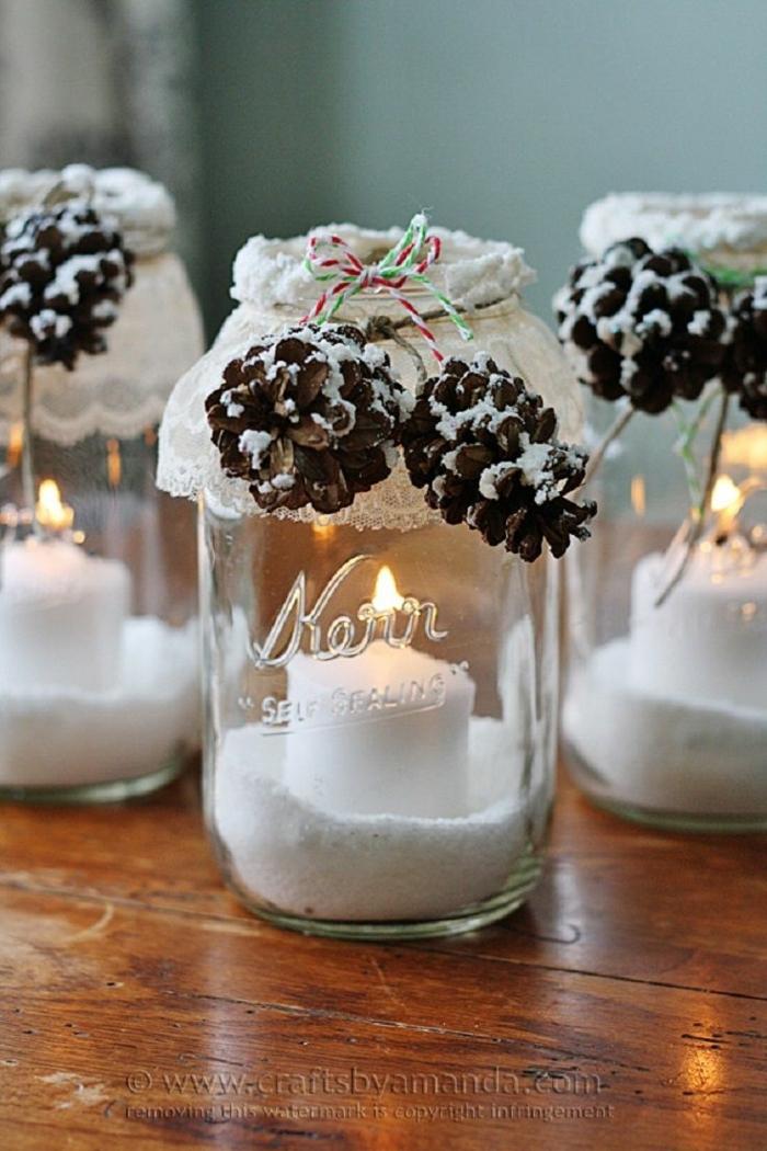 centros navideños, propuesta con frascos decorativos hechos a mano con vela dentro y efecto de nevado