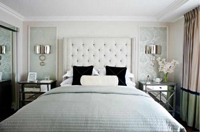 dormitorios de matrimonio, habitación con grande cama con cabecero en capitoné color beige, elementos en color verde menta