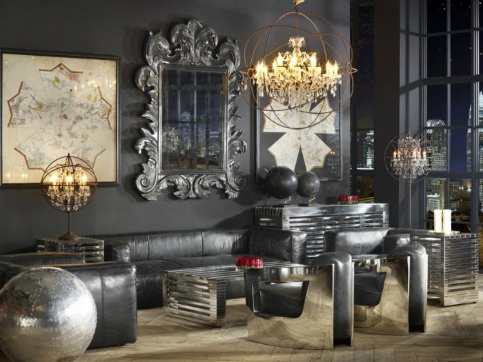 estilo vintage, salón en tonos oscuros, sofá tapizada de piel negro, detalles en color plata, candelabros vintage