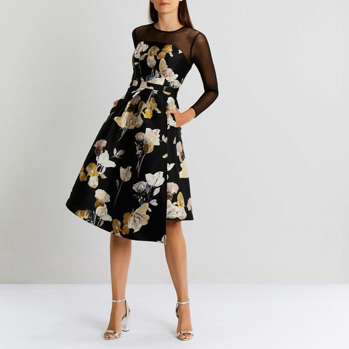 vestidos de fiesta largos, vestido de corte asimétrico en negro con estampado de grandes flores, mangas y escote detela transparente
