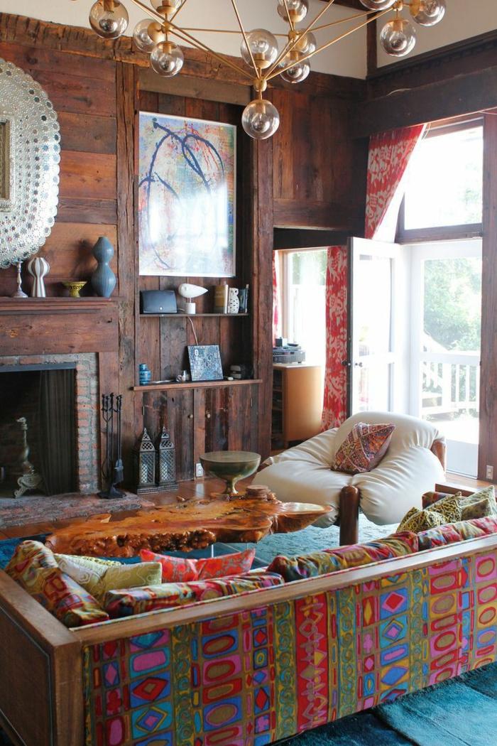 salones modernos, salón en estilo rústico con toques bohemios, lámpara de araña moderna, chimenea de leña