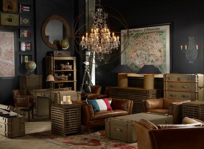 vintage, salon con paredes en negro, sillones de piel marrón, decoración de mapas viejas, alfombra vintage