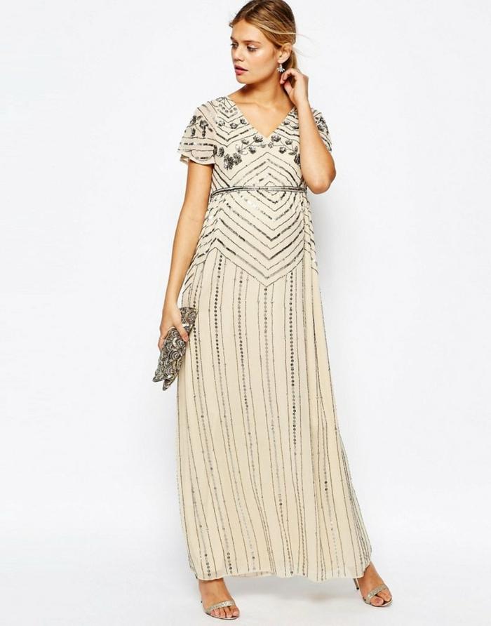 vestidos de fiesta largos, vestido largo liviano en estilo bohemio, cintura alta, color beige con ornamentos en plateado, bolso brillante