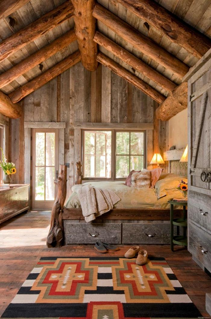 cabañitas del bosque, preciosa choza acogedora hecha de madera, techo con vigas de madera, cama doble, alfombra en motivos geométricos