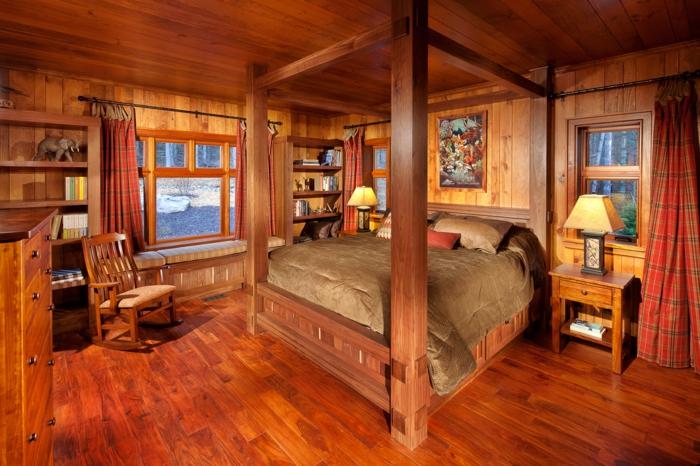 cabañas con encanto, dormitorio de madera con cama vintage de marco alto, cortinas en rojo y suelo de parquet