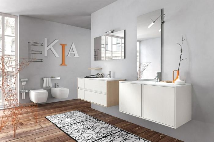 laminas decorativas, baño moderno con dos lavabos, suelo de madera, ventanal, decoración con letras grandes en blanco y naranjado