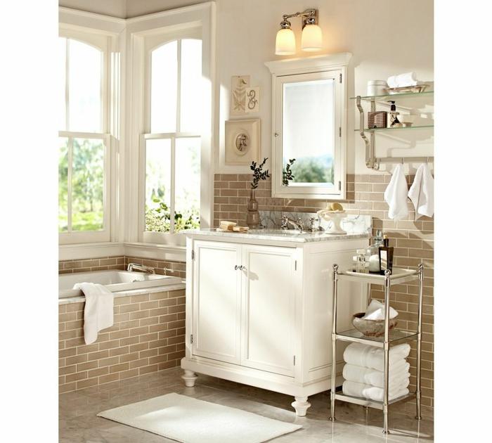 marcos vintage, baño con bañera y mucha luz natural, ladrillo visto, decoraciñón con cuadros pequeños y herbarium