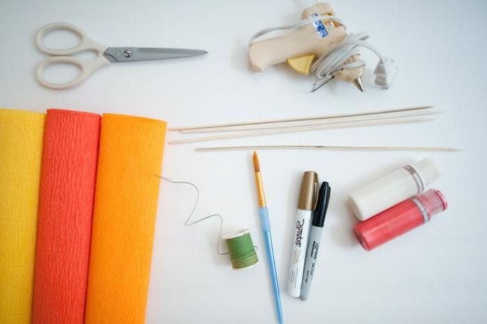 mariposas de papel, materiales necesarios para hacer mariposas de papel, papel crepe, pistola de pegamento, pinceles, marcadores