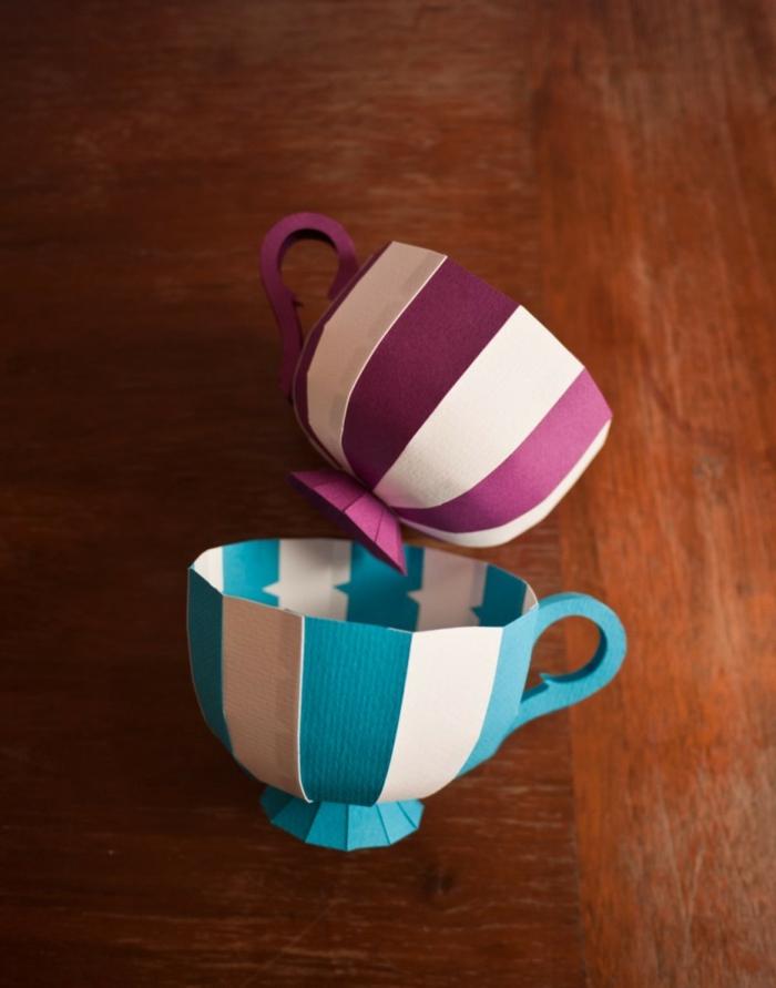 como hacer cosas de papel, tazas de té hechas con cartón en azul, blanco y púrpura, tutorial paso a paso, mesa de madera