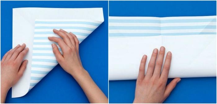 manualidades con papel de periodico, tutorial para doblar un cuadrado de papel para conseguir la forma de una estrella, decoracion colgante de papel