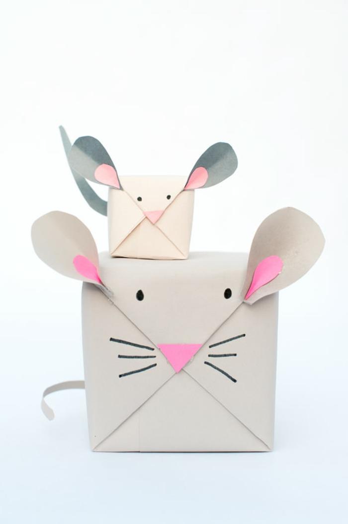 manualidades con papel de periódico, paquetes para regalos de papel con caritas de ratónes grande y pequeño, orejas y nariz en rosa