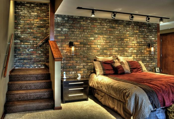 paneles decorativos, dormitorio en estilo industrial con luz artificial, cama doble, escaleras y paredes de ladrillo esmaltado