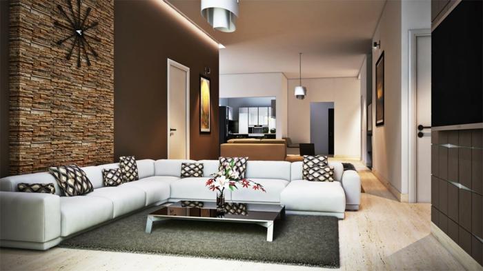 revestimiento de paredes, salón grande con techos altos, pared de piedra con reloj negro, sofá blanca en forma de L