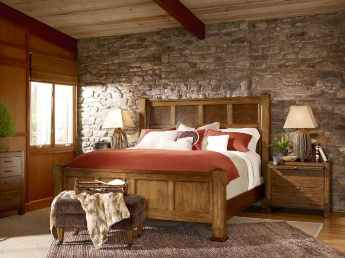 ladrillo visto, dormitorio en estilo rústico con pequeña ventana, techo de madera y pared de piedra, cama doble y alfombra