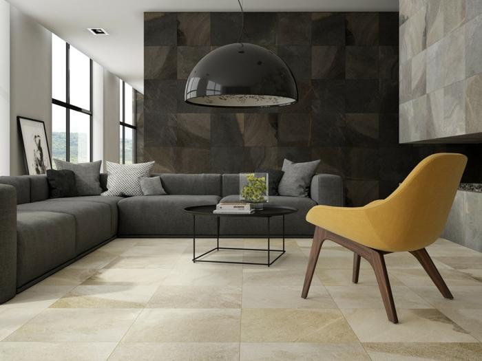 revestimiento de paredes, sal'on minimalista en gris, silla amarilla, paredes de bloques de piedra, ventanas grandes