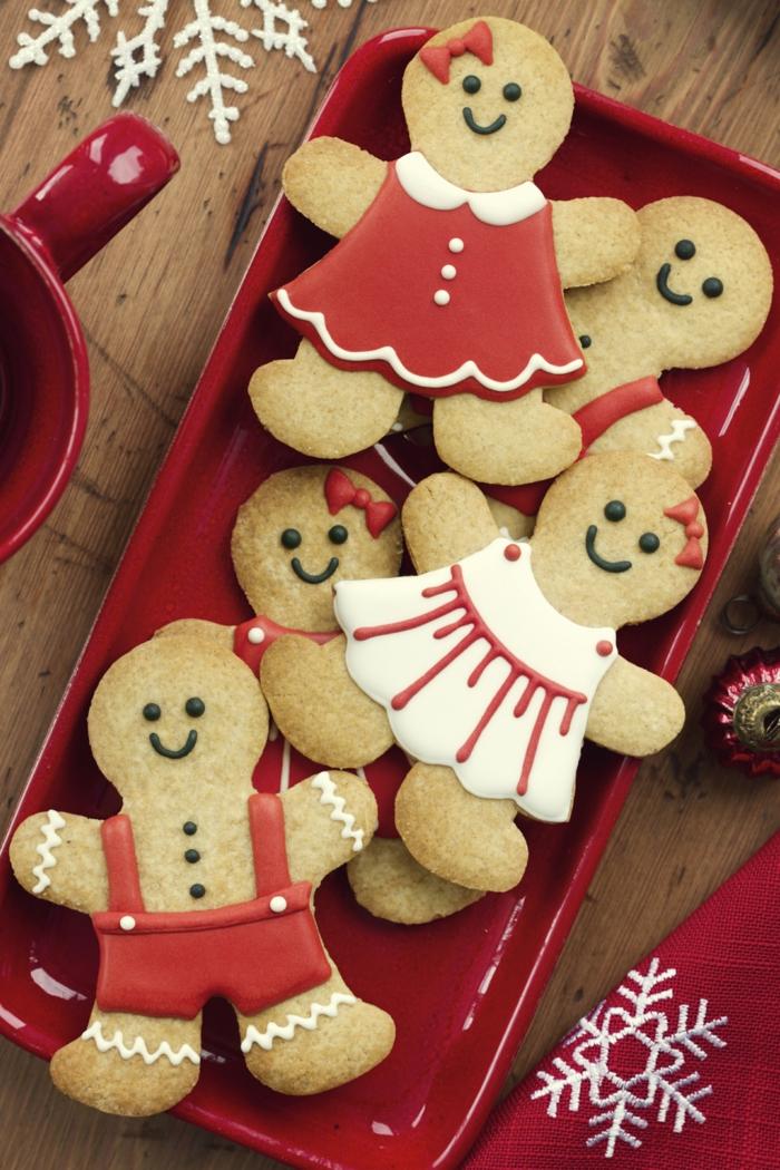 receta galletas de mantequilla, propuesta de galletas atractivas decoradas con glaseado en rojo y blanco, galletas con la forma de hombres