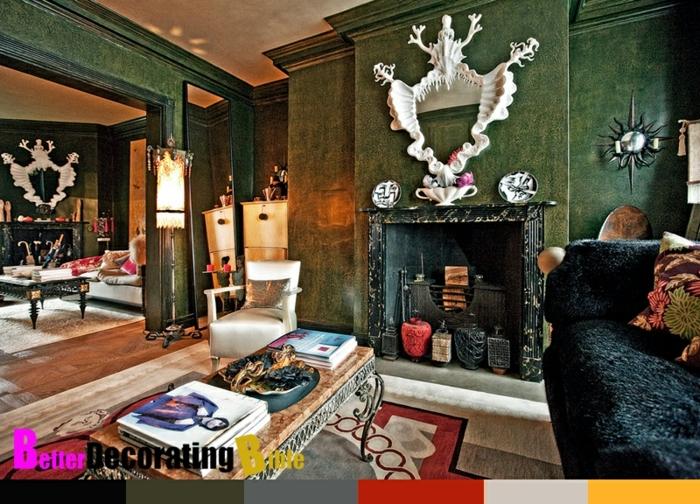decoracion de salones pequeños, grande salón verde con chimenea de leña, suelo de madera con alfombra en motivos geométricos