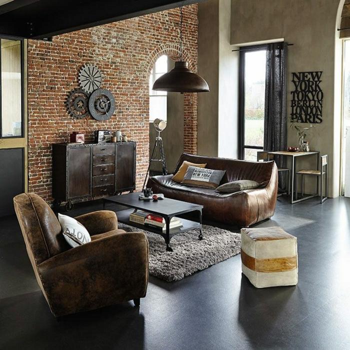 habitacion vintage, interior en estilo industrial, vinillo decorativo en la pared, paredes de ladrillos, dos sofás de piel en marrón, suelo de mármol