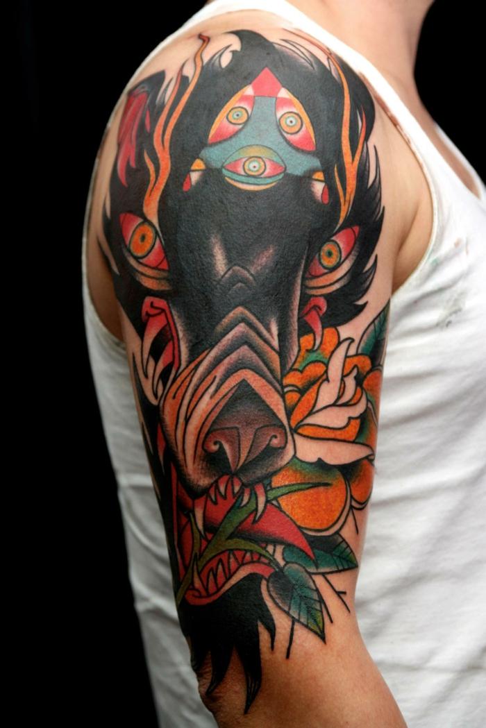 tatuaje lobo, tatuaje en hombro y brazo de color, estilo neotradicional, cabeza de lobocon ojos rojos, flores