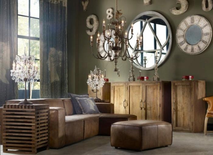 salones vintage, salon en tonos oscuros, sofá tapizada de piel en marrón, armarios de madera, grande espejo vintage
