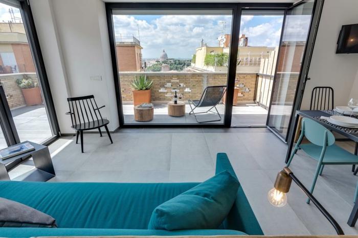 precioso ejemplo de diseño de terraza, terrazas con encanto decoradas en estilo moderno, salón en estilo contemporáneo, sofá en color aguamarina