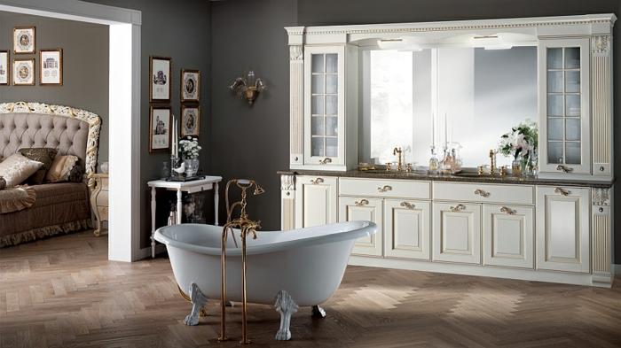 espacio en estilo vintage con toque moderno, baños rusticos abiertos al salón, paredes en gris decoradas de cuadros decorativos, detalles en dorado