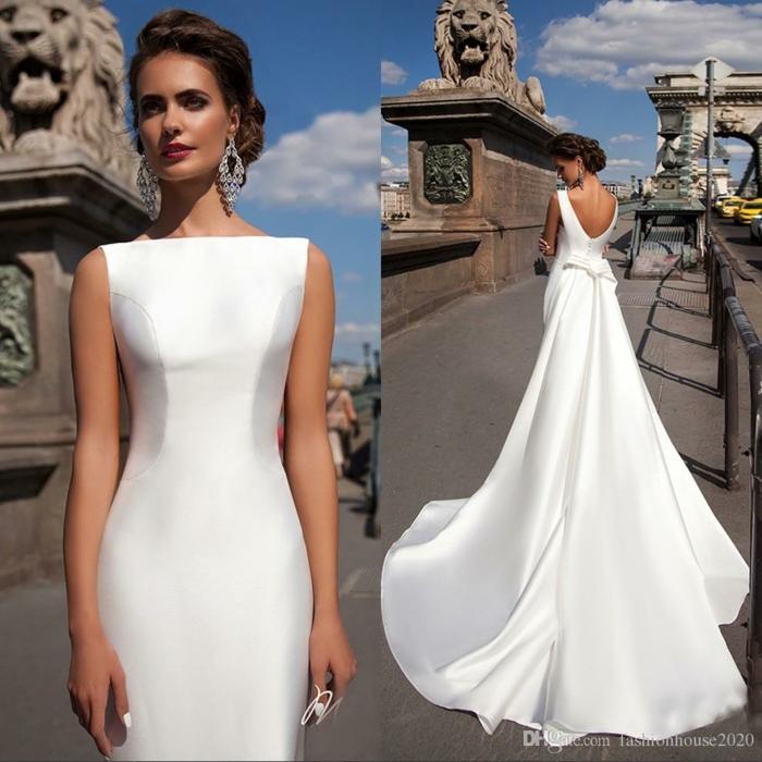 vestidos de novia sencillos, vestido muy largo con moño en la espalda, corte muy sencillo con espalda descubierta