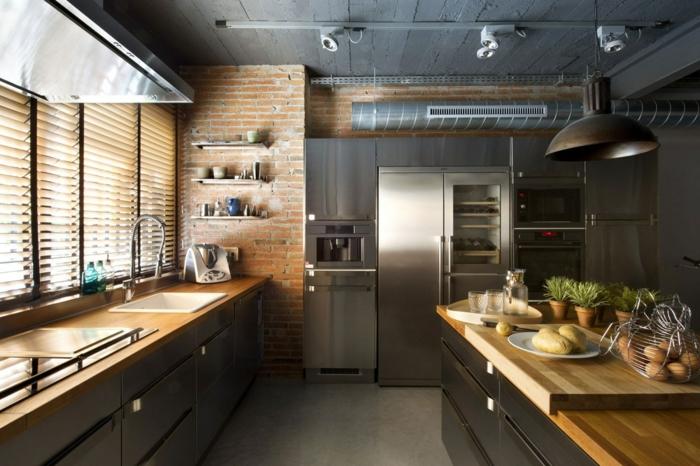 diseño de cocinas en estilo industrial, paredes de ladrillos, muebles laminados y grande barra con encimera de madera