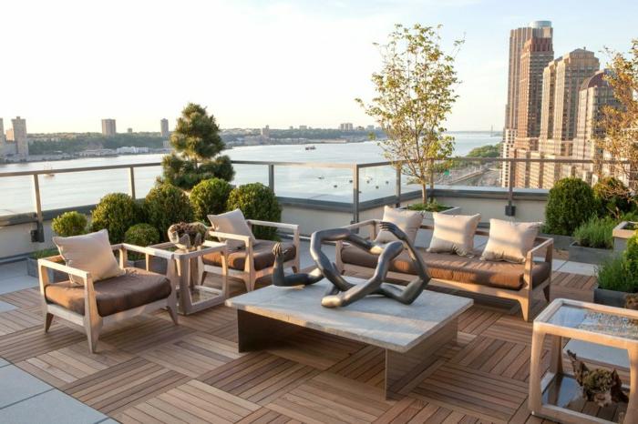 diseño original de una terraza grande con vista a la ciudad, decoracion terrazas de estilo moderno, mesa con interesante decoración