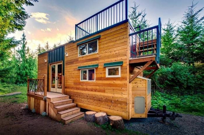casas moviles, casa prefabricada de diseño muy atractivo, techo optimizado, bonita terraza con vista al bosque