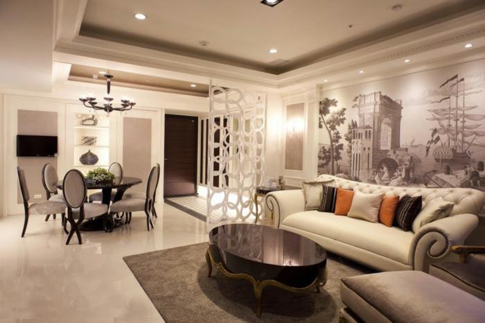 separadores de ambientes, grande salón con comedor, divisor de espacios original, paredes en beige con vinilos decorativos y mesa vintage