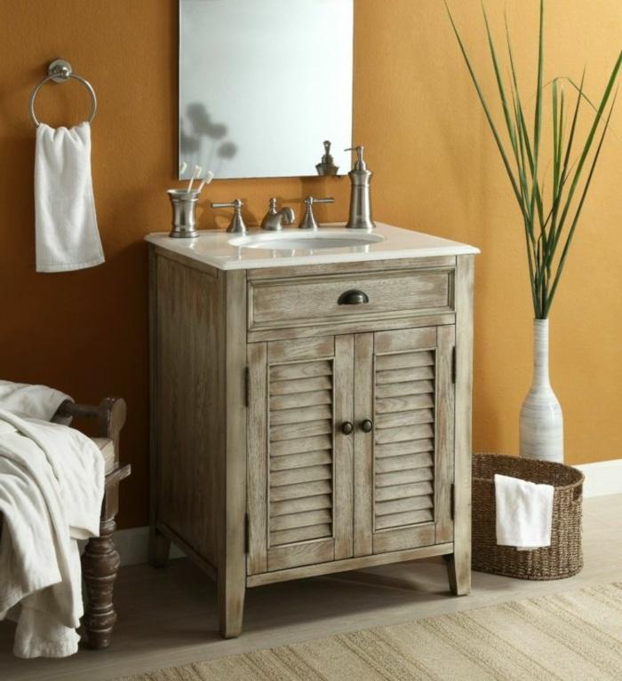 detalles de madera para una decoracion rustica, armario de madera en tonos claros, pared color ocre y decoración de plantas verdes