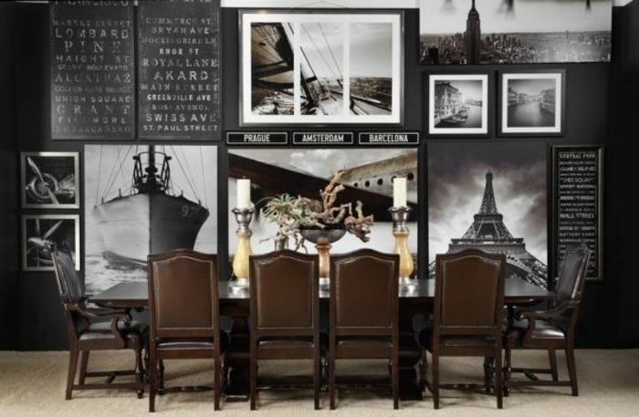 decorar con fotos, comedor moderno con muebles vintage en marrón y pared pintada en negro con grandes fotos decorativas en blanco y negro