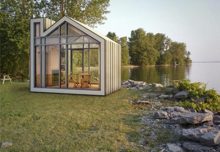 casas moviles, diseño atractivo de una casa pequeña con dos paredes de cristal, bonita vista al lago