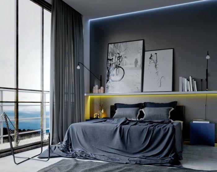 habitación en estilo contemporáneo decorada en los tonos del gris, grandes ventanales con vista y cuadros decorativos