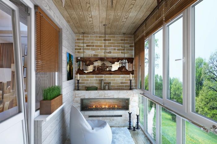 ejemplo de pequeño balcón decorado de estilo moderno, decorar terrazas con estilo, suelo de madera y pared de ladrillo