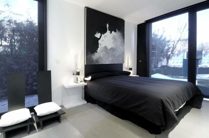 cuadros vintage para dormitorio espacioso y luminoso decorado en blanco y negro, grandes ventanales con vista