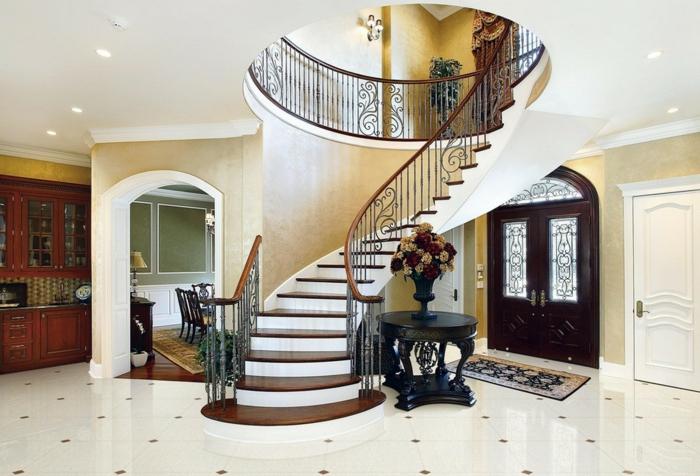 escaleras, recibidor grande moderno lujoso, escaleras de caracol de obra con barandilla de madera, suelo con baldosas