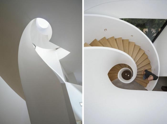 escaleras de interior, escalera de caracol grande con barandilla y base de hormigón blanco y escalones de madera