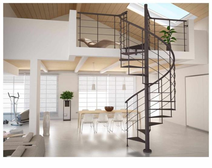 escaleras de interior, salón con mucha luz natural, mesa de madera, suelo laminado, balcón interior, escalera de caracol metallica