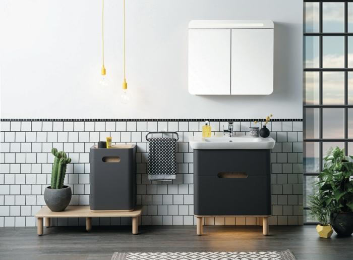 mueble lavabo, decoración de baños moderna, muebles negros tipo contenedor con patas de madera, cactus, lámparas colgantes, ventana grande, tapete