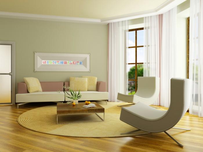 combinacion de colores, salón estilo moderno, mesa de madera baja, alfombra redonda de mimbre, ventanas grandes, paredes en verde seco, techo amarillo pálido